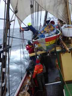 14 April Getting a tackle on the foresail clew to haul down the sheet