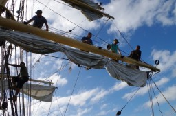 Allafia, Aaron, Bruce, Rob and Gabe bend the foresail compressed
