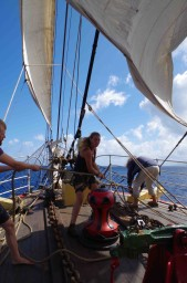 Erin, Rob and Alex tack down the foresail