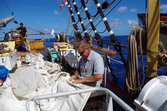 John making sails_ Russell on the helm