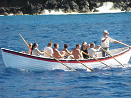 Photo of the Captain and the Crew Rowing the Monomy off Pitcairn Island