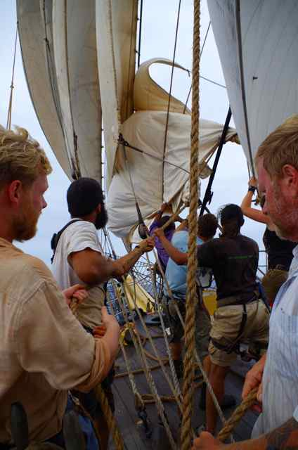 Taking in topmast studding sail on an earlier voyage